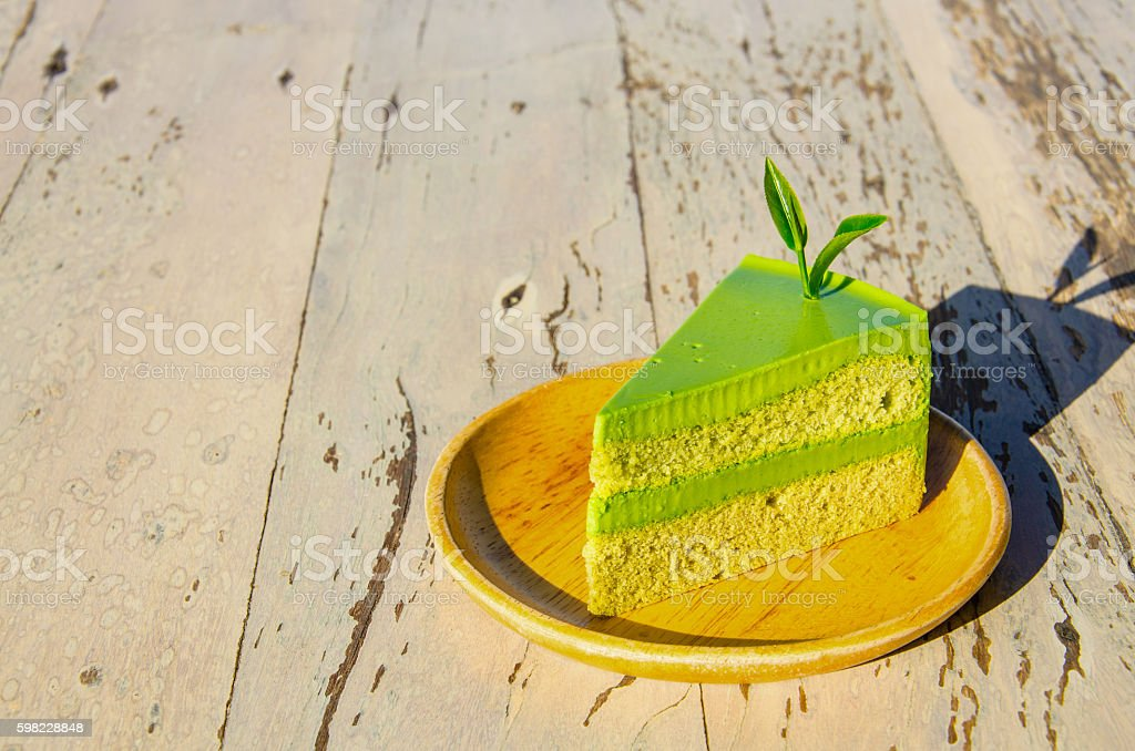 Green Tea Cake on the Wood Table foto royalty-free