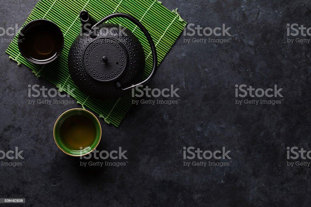 Green tea cups and teapot stock photo