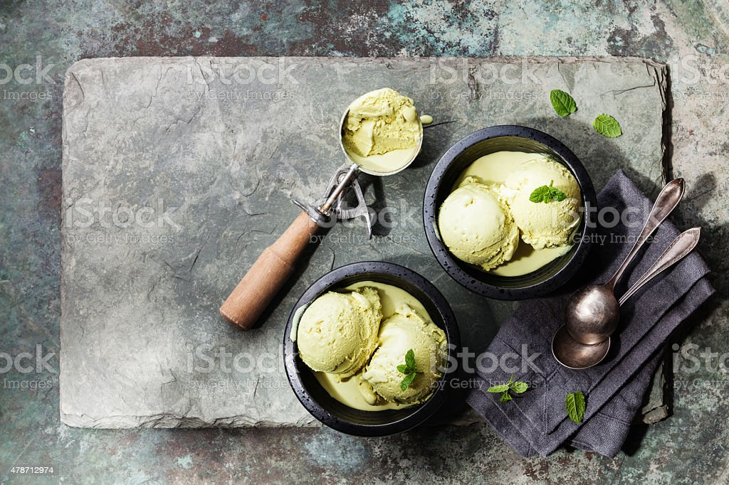 Green tea ice cream with mint leaves and Spoon for ice cream stock photo