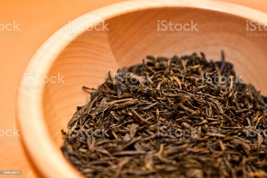 Green tea in a wooden bowl stock photo
