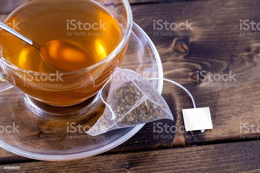 Green tea in glass teacup stock photo