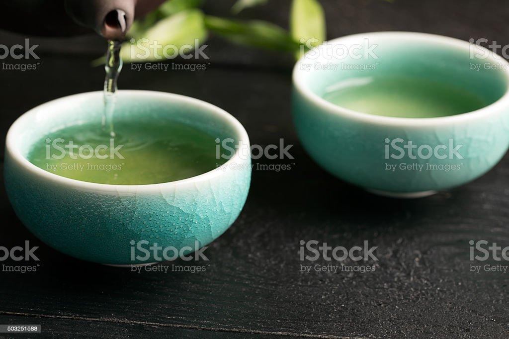 Green tea in the tea cups stock photo