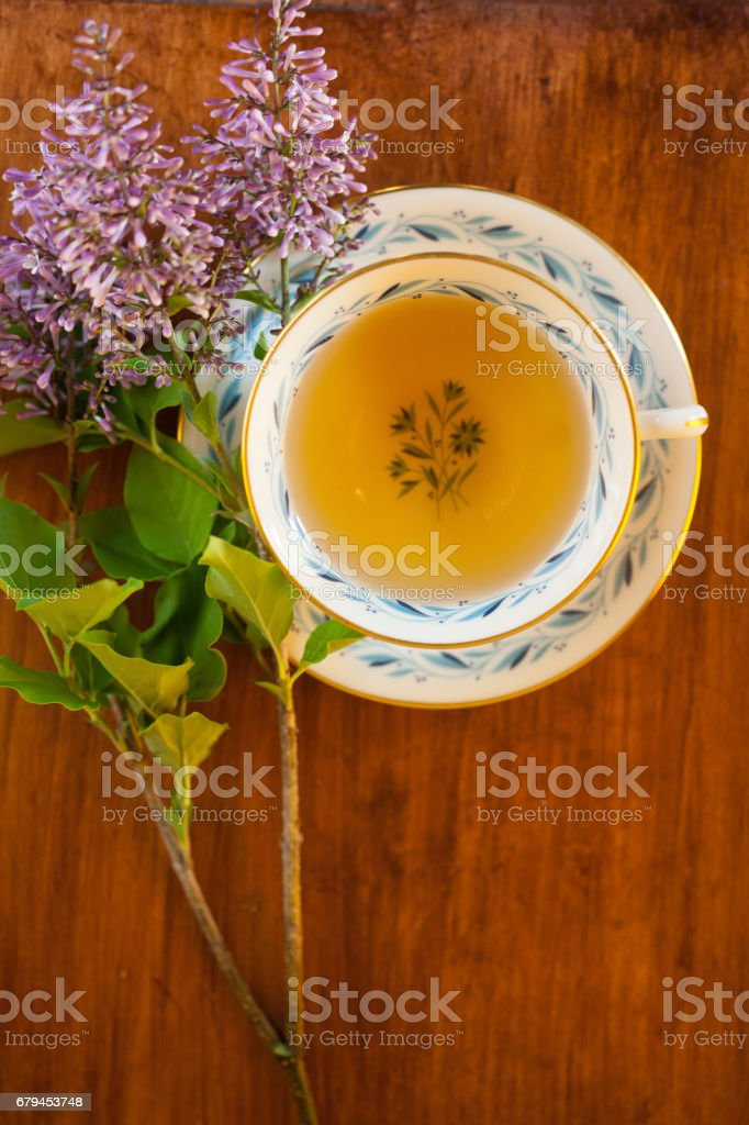 Green Tea in vintage cup with flowers royalty-free stock photo