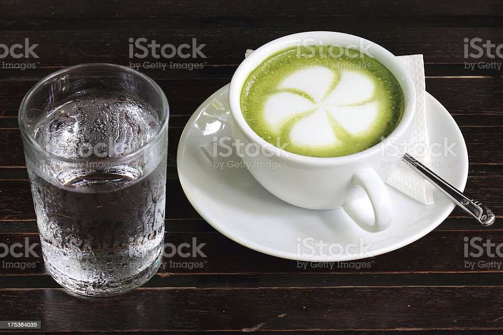 Green tea Latte with cold water royalty-free stock photo