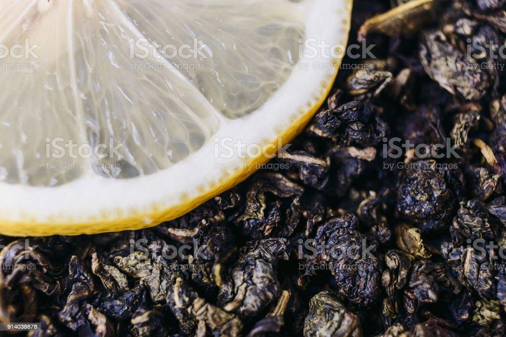 green tea leaves and a lemon wedge stock photo