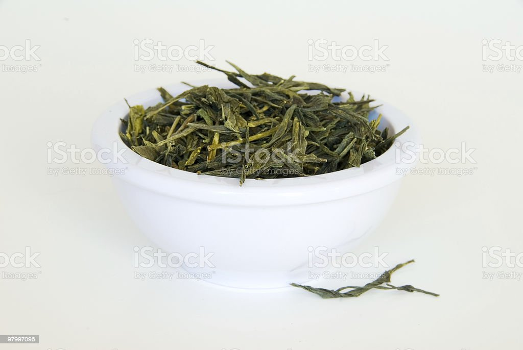 Green tea leaves in a bowl royalty-free stock photo