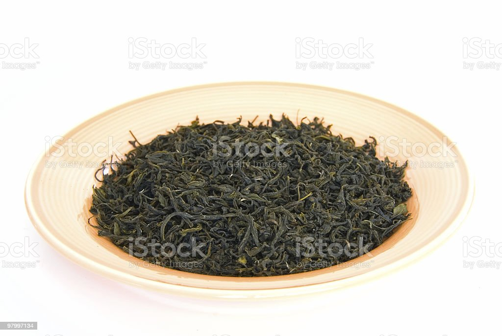 Green tea leaves on plate royalty-free stock photo
