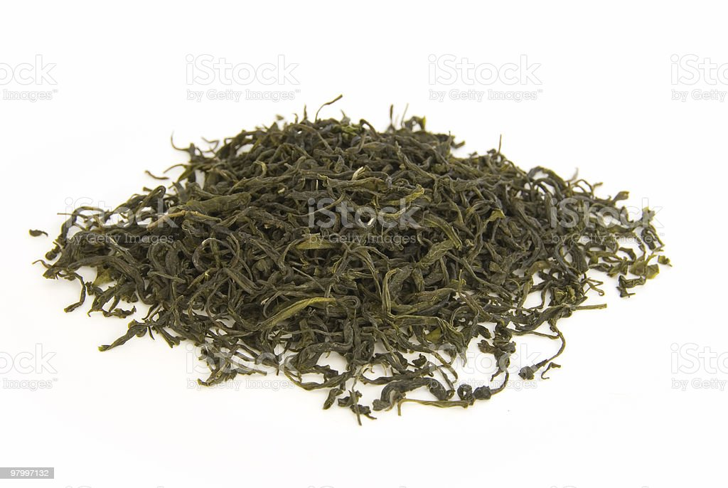 Green tea leaves on white royalty free stockfoto