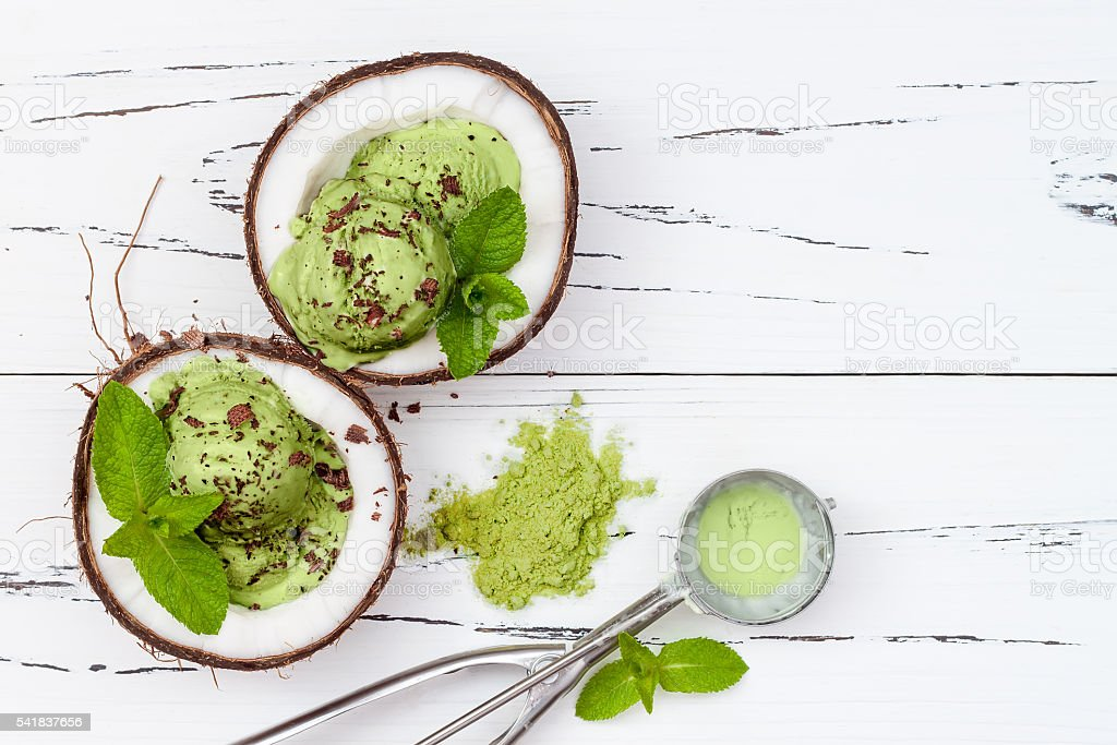 Green tea matcha mint ice cream with chocolate, coconut milk stock photo