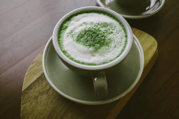 Green tea matcha on wooden table. stock photo