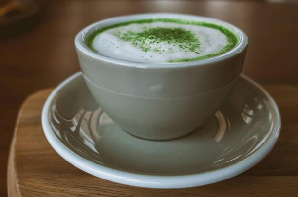 Green tea matcha on wooden table stock photo