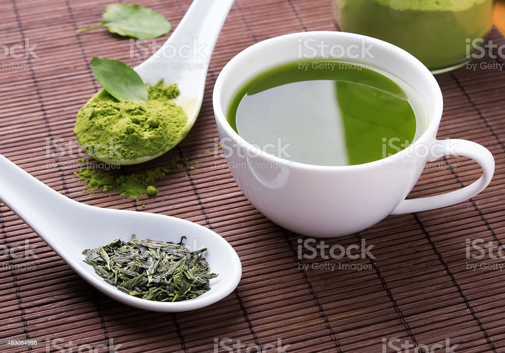 Green tea n the brown mat stock photo