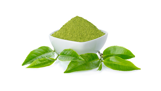 Green tea Powder with cup and green tea leaf on white background