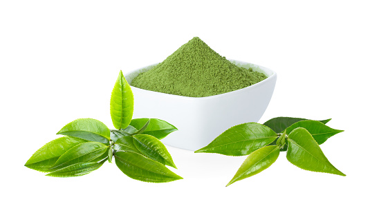 Green tea Powder with cup and green tea leaf on white.