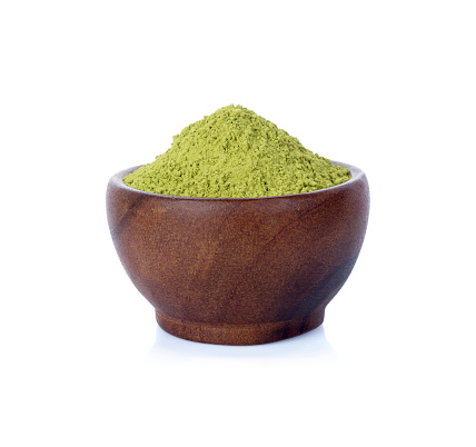 green tea powder with wooden cup isolated on white