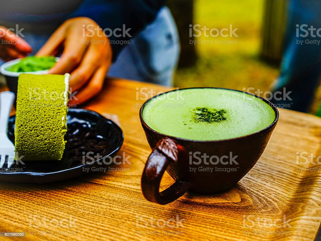 Green tea roll cake and green tea latte coffee stock photo