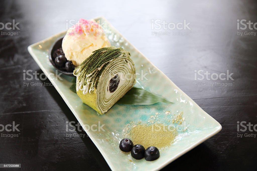green tea roll cake with ice cream stock photo