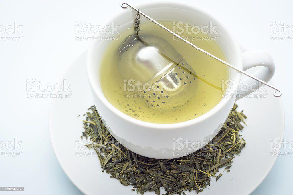 Green tea with an infuser royalty-free stock photo