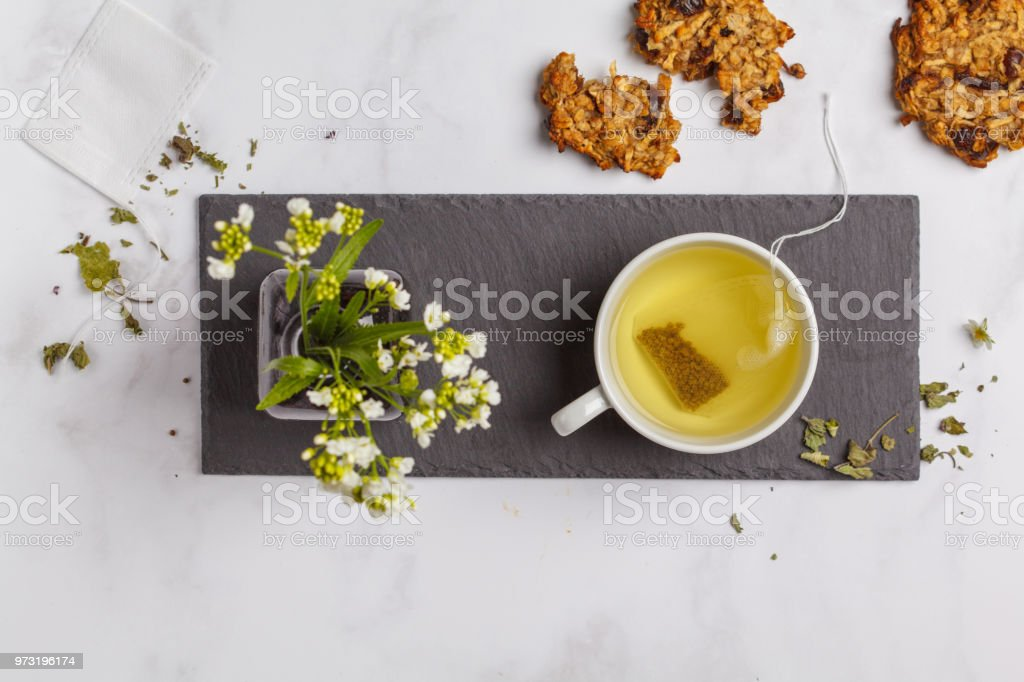 Green tea with cookies on white background. Flat lay food, breakfast...