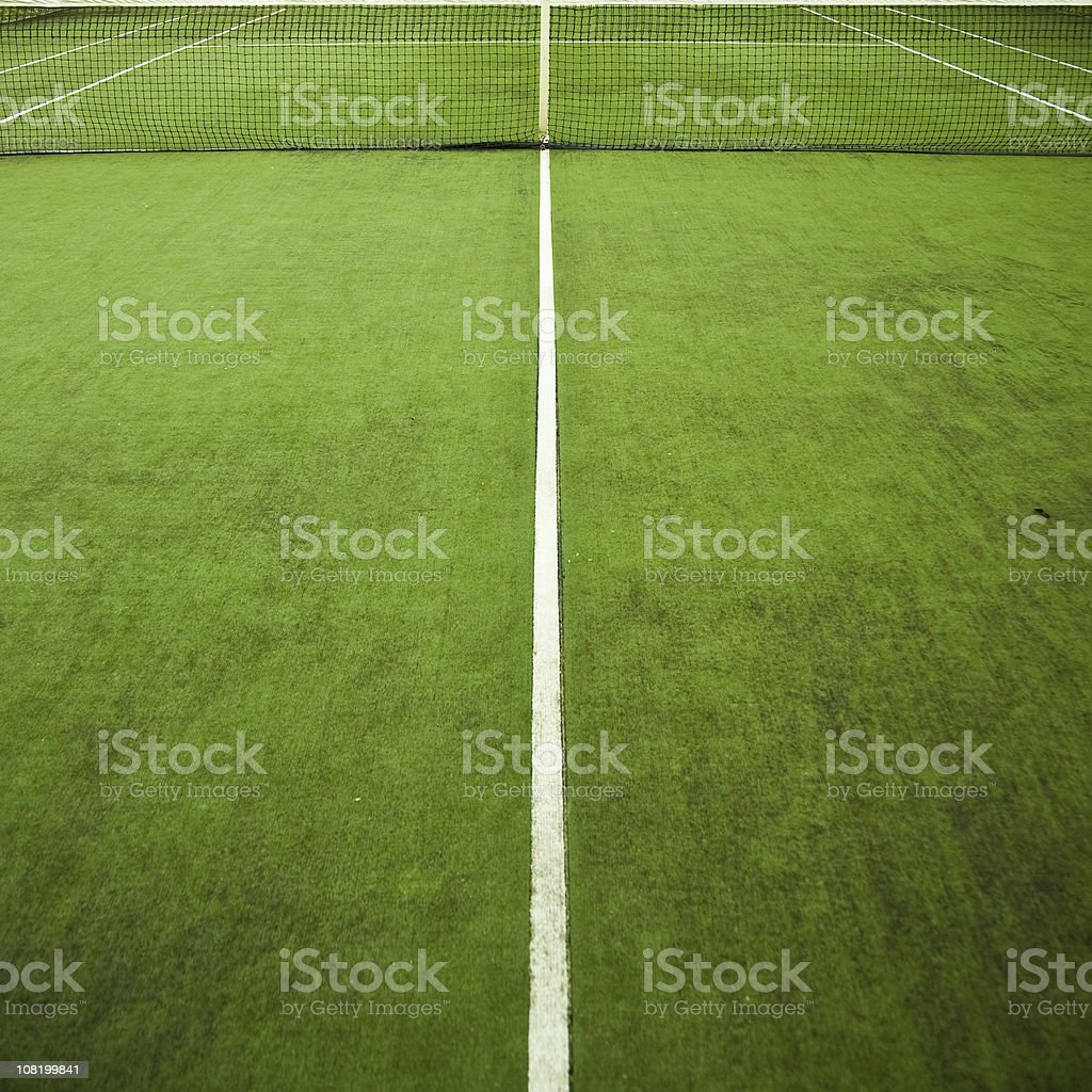 Green Tennis Court with Net and White Lines stock photo