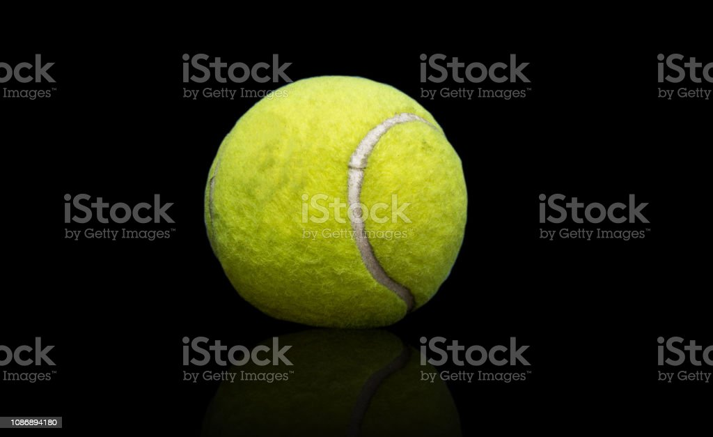 Green tennis separated from the background. stock photo