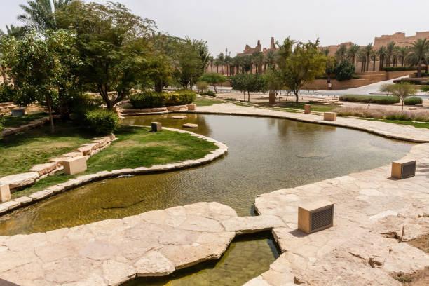 Green terraces and artificial ponds of Al Bujairi Park stock photo