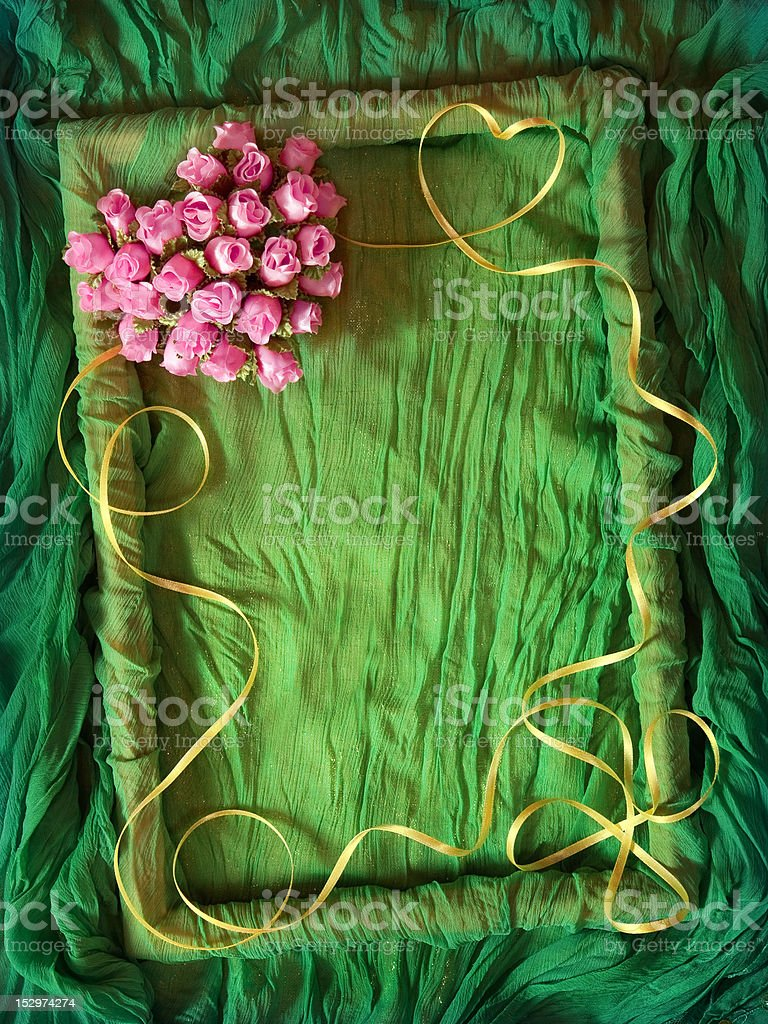 Green textile frame with rose heart royalty-free stock photo