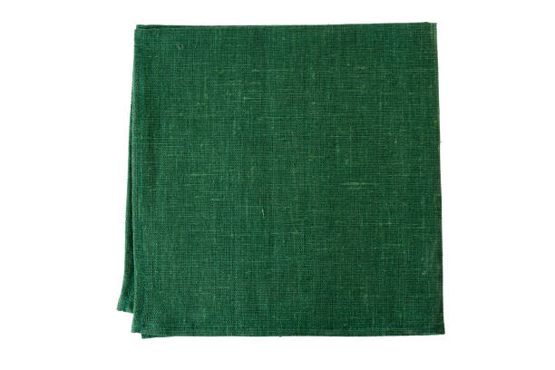 green textile napkin on white - rag stock pictures, royalty-free photos & images