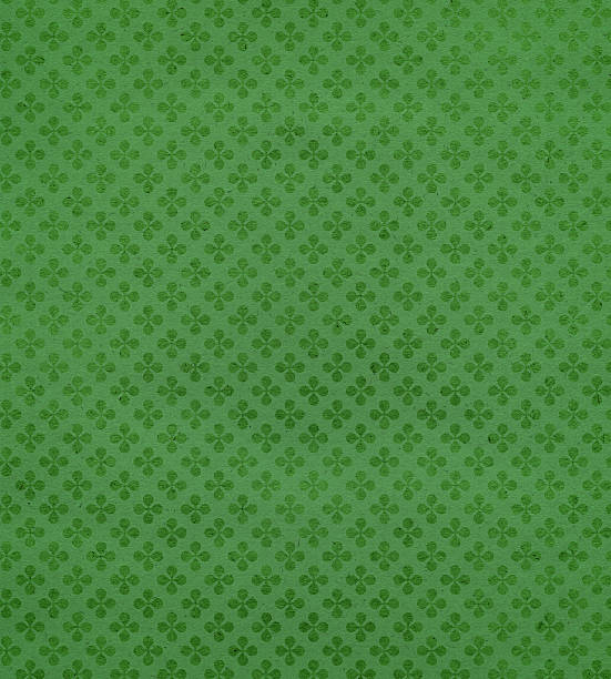 green textured paper with clover - st patricks day background stock photos and pictures