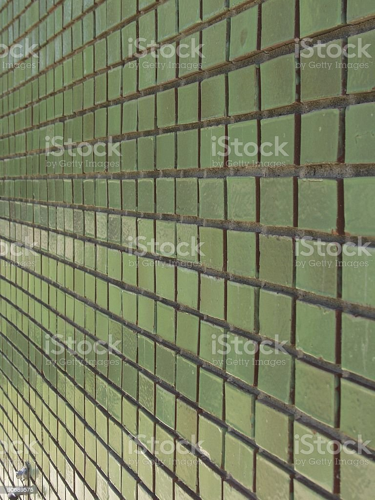 Green tile wall angled royalty-free stock photo