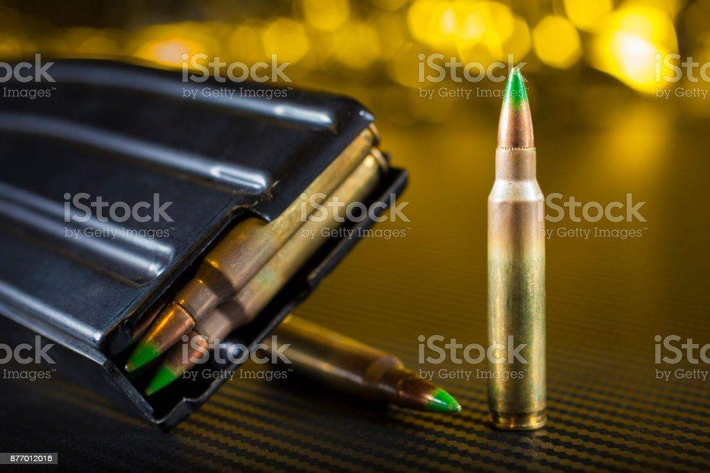 Green tipped AR-15 bullet stock photo