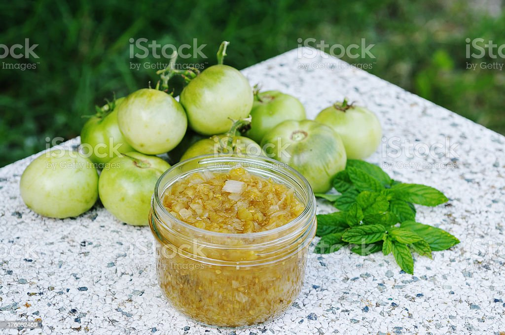 Green tomato paste along with green tomatoes stock photo