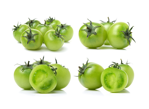 Green tomatoes on the white background
