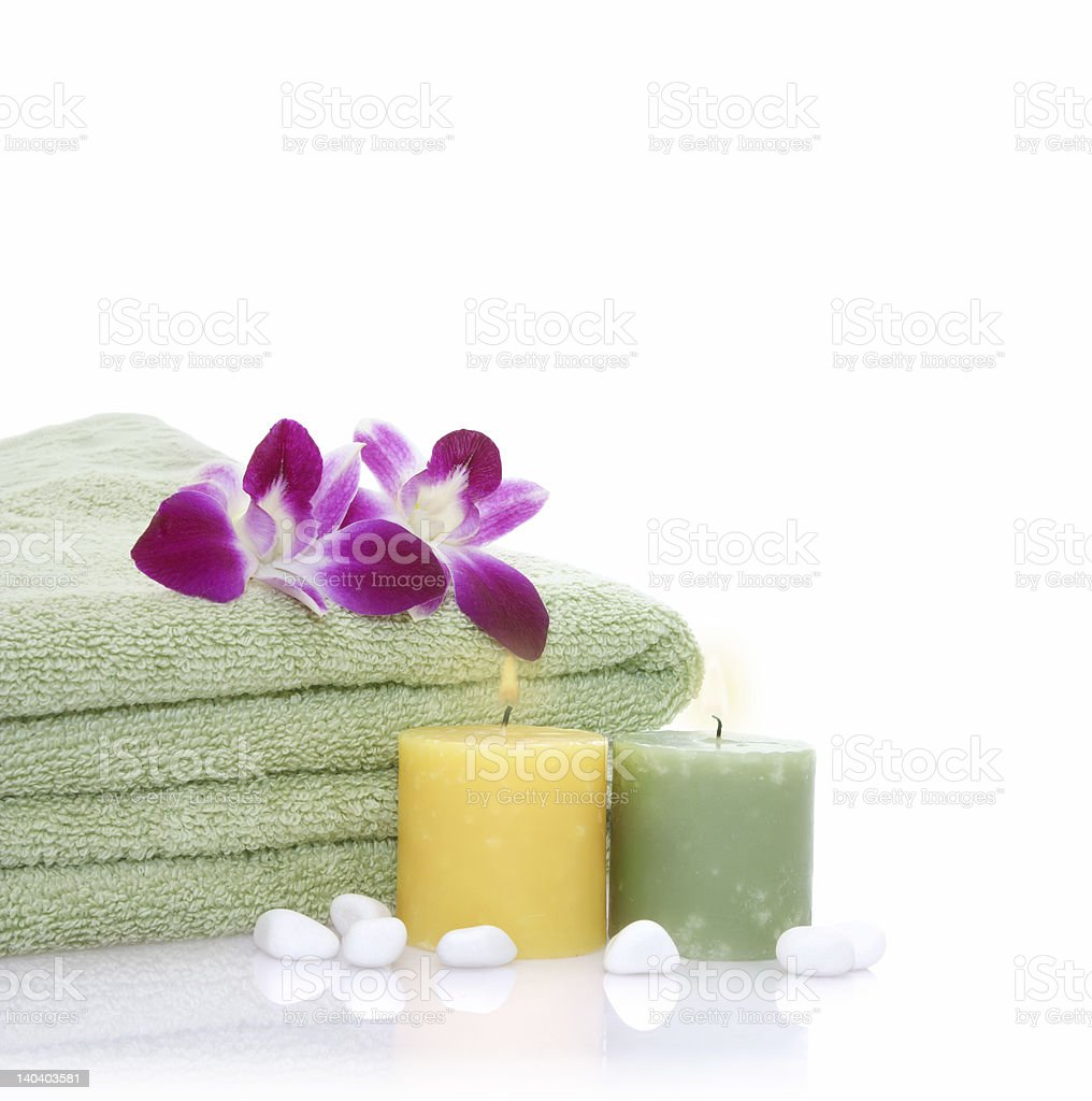 Green Towel, Orchid, Candles and Pebbles royalty-free stock photo