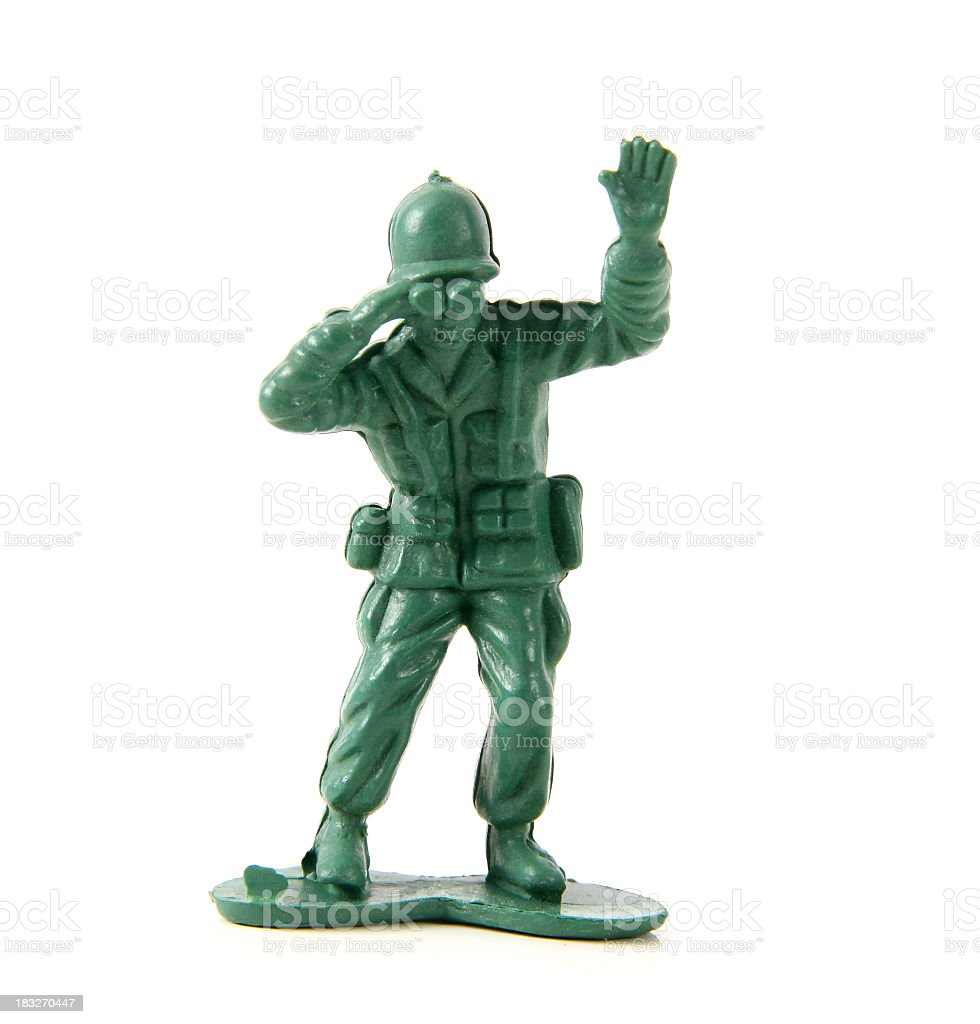Green toy soldier looking through binoculars on white back stock photo