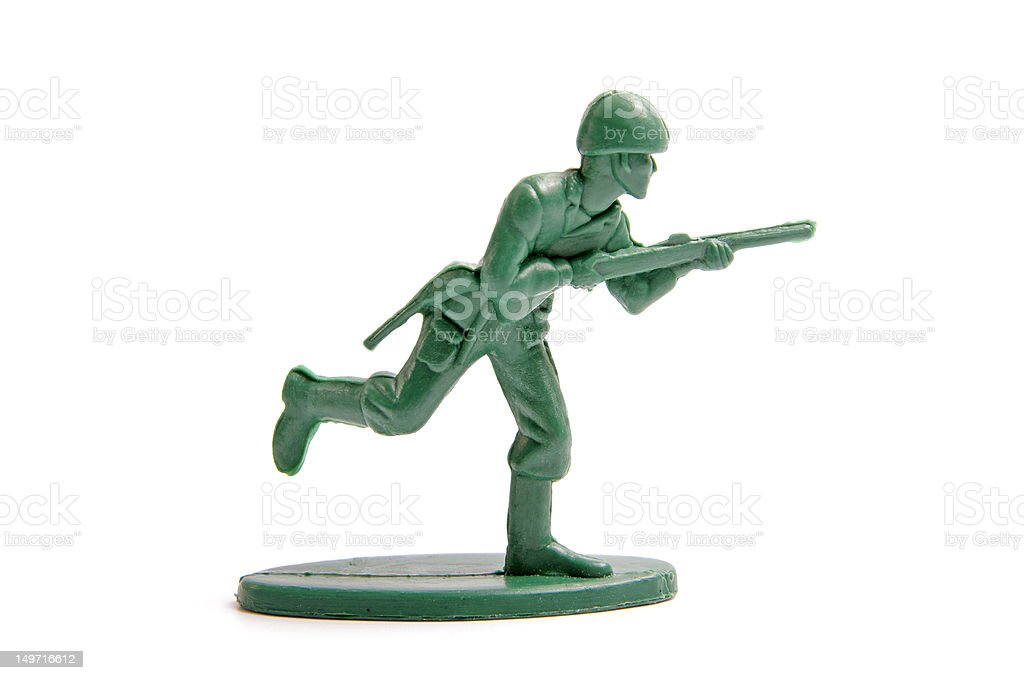 green toy soldiers on white background stock photo