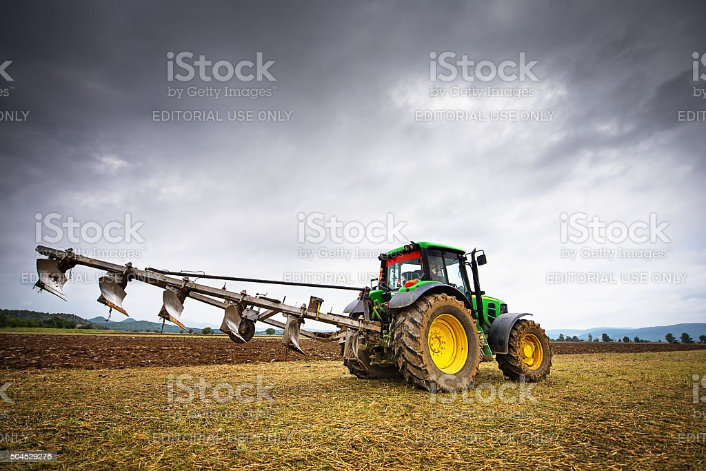 Green tractor. stock photo