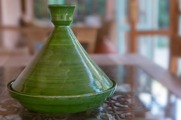 Green, traditional Moroccan ceramic tagine (tajine). Authentic, traditional expensive, high quality ceramic that can be used for cooking. stock photo
