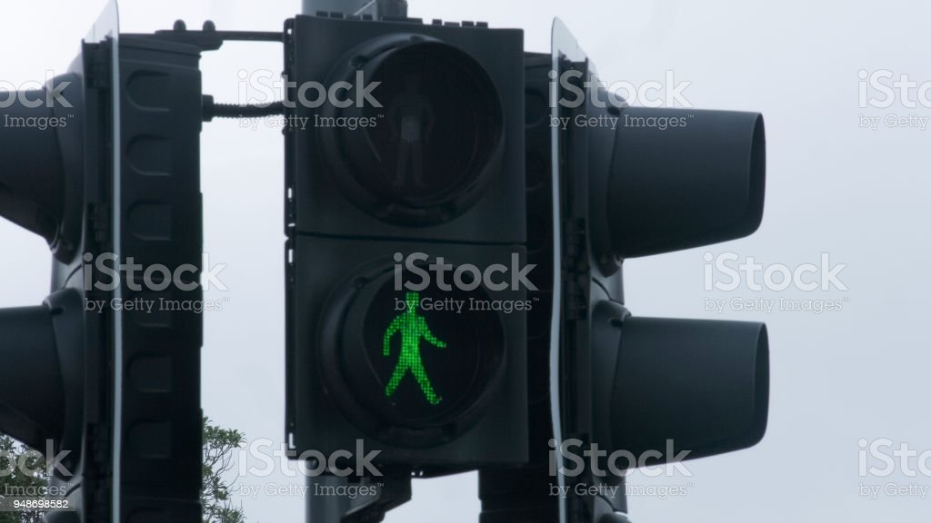 Green traffic light at crossroads, grant permission, project accept, new startup stock photo