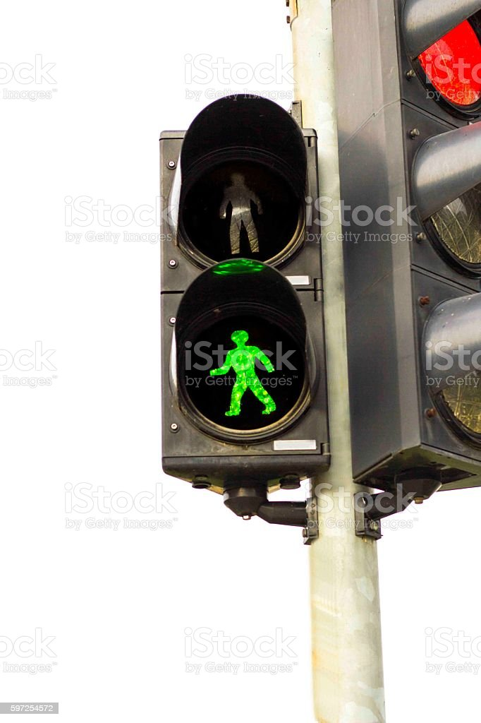 Green traffic light for pedestrian. Red for cars. stock photo