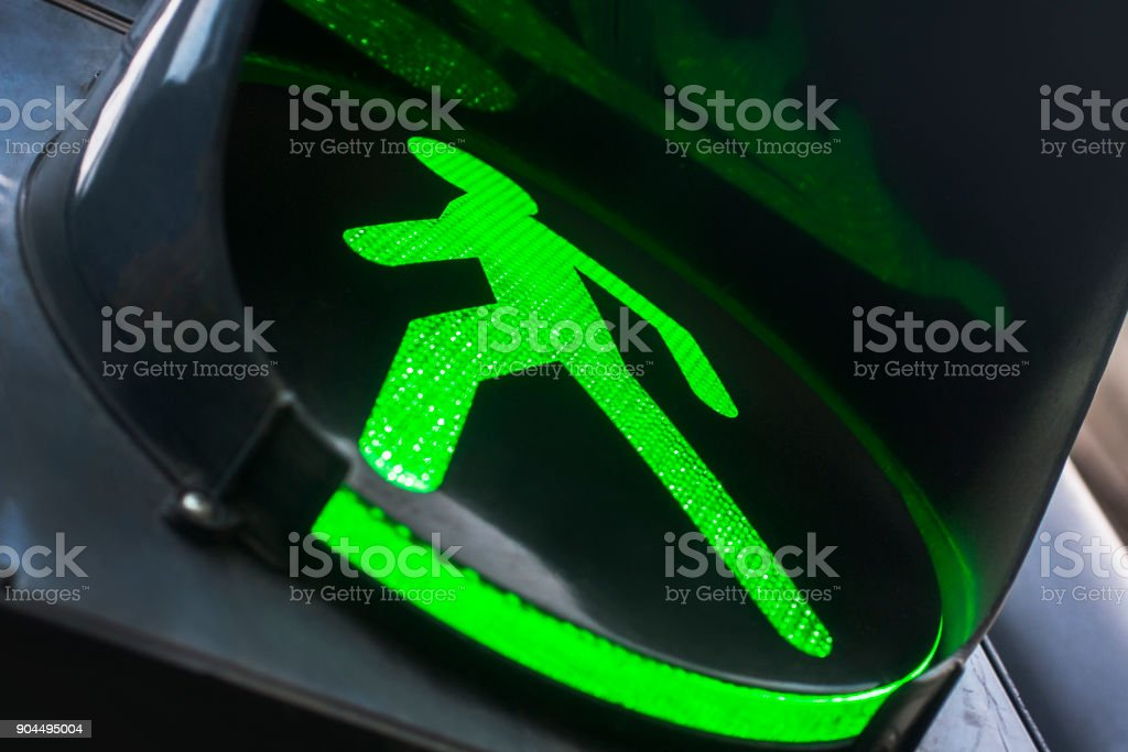 Green traffic light for pedestrians. stock photo