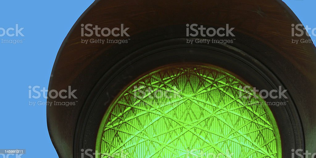 Green traffic light with blue background royalty-free stock photo