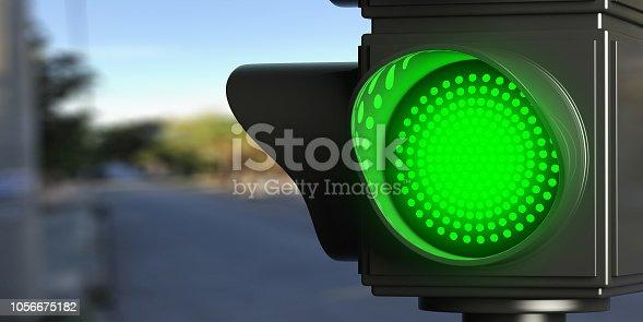 istock Green traffic lights on blur street background, copy space. 3d illustration 1056675182