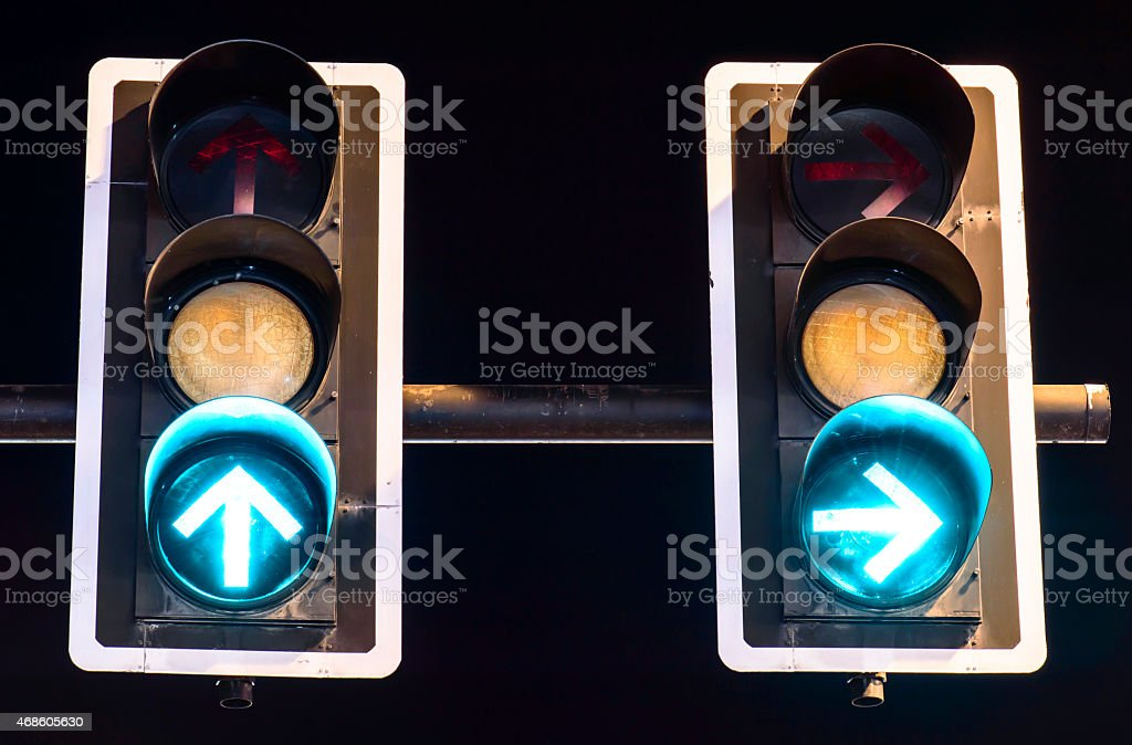 Green traffic lights on night background stock photo