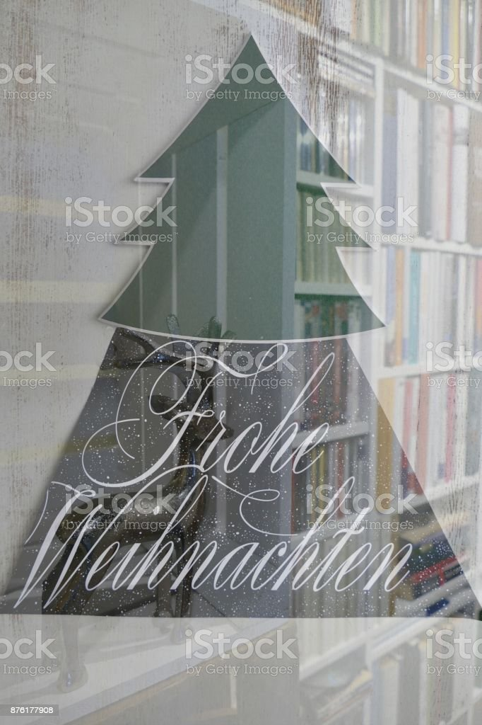 Green Tree Shape And Frohe Weihnachten On Books Background Stock