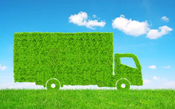 Green Truck in grass. stock photo