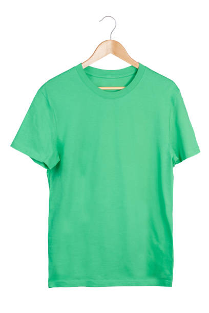 Green t-shirt on hanger Green t-shirt on hanger isolated on white coathanger stock pictures, royalty-free photos & images