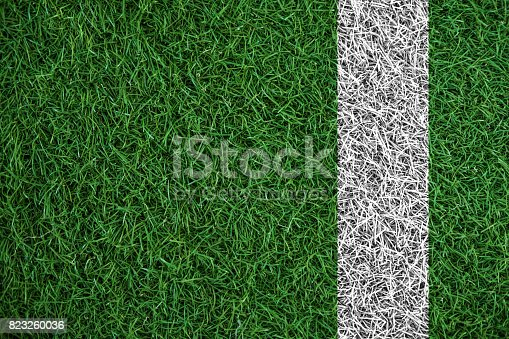 istock Green turf grass texture with white line, in soccer field 823260036