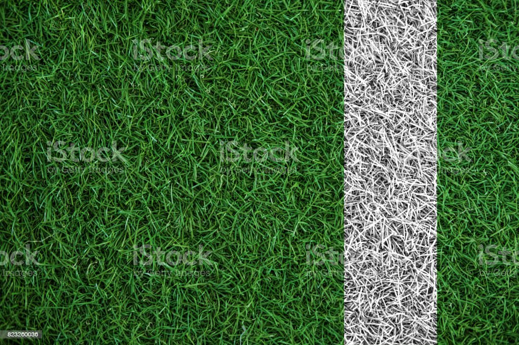 Green turf grass texture with white line, in soccer field stock photo