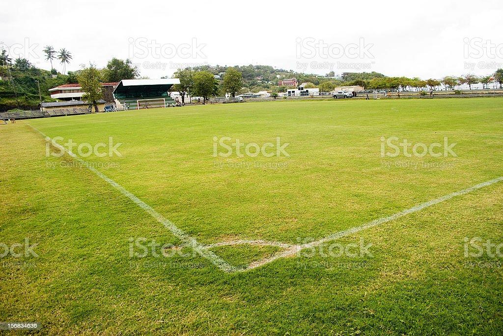 green turf playing field with corner box wide angle stock photo